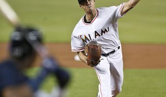 Miami Marlins starting pitcher Wei-Yin Chen, of Taiwan, delivers during the first inning of a baseball game against the Atlanta Braves, Tuesday, July 24, 2018, in Miami. (AP Photo/Brynn Anderson)