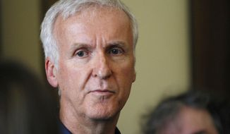 FILE - In this Jan. 14, 2015, file photo, movie director James Cameron talks to reporters at an event in Wellington, New Zealand.  Filmmaker Cameron is backing a bid announced Tuesday July 24, 2018, by a group of British museums to raise US dollars 20 million (15 million pounds) to buy 5,500 Titanic artefacts from the private American company that salvaged them from the wreck of the passenger liner RMS Titanic.(AP Photo/Nick Perry, File)