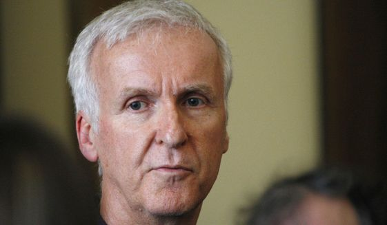 Movie director James Cameron talks to reporters at an event in Wellington, New Zealand, Jan. 14, 2015. Filmmaker Cameron is backing a bid announced Tuesday July 24, 2018, by a group of British museums to raise US dollars 20 million (15 million pounds) to buy 5,500 Titanic artefacts from the private American company that salvaged them from the wreck of the passenger liner RMS Titanic.(AP Photo/Nick Perry) ** FILE **