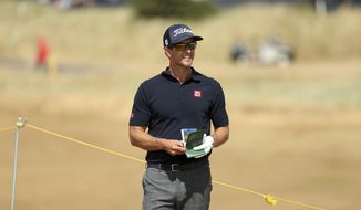 Adam Scott of Australia looks along the 2nd fairway during the final round of the British Open Golf Championship in Carnoustie, Scotland, Sunday July 22, 2018. (AP Photo/Peter Morrison)