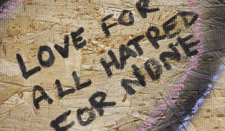 Messages people wrote are shown on a makeshift memorial, Tuesday, July 24, 2018, in Toronto, for the victims of Sunday's shooting. Canadian investigators said Tuesday there was no link to terrorism in the mass shooting that killed two people and wounded 13 as they continued to probe the life of the 29-year-old gunman for clues to what prompted the rampage that targeted diners at restaurants and cafes in a popular Toronto neighborhood. (Mark Blinch/The Canadian Press via AP)