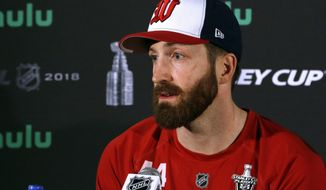 FILE - In this June 3, 2018, file photo, Washington Capitals defenseman Brooks Orpik speaks to the media at Kettler Capitals Iceplex in Arlington, Va. The Washington Capitals are bringing back veteran defenseman Brooks Orpik. The Capitals on Tuesday, July 24, 2018, signed Orpik to a $1 million, one-year contract with $500,000 in performance bonuses. General manager Brian MacLellan announced the signing about a month after trading Orpik to Colorado in a salary-cap clearing move. (AP Photo/Bill Sikes) ** FILE **