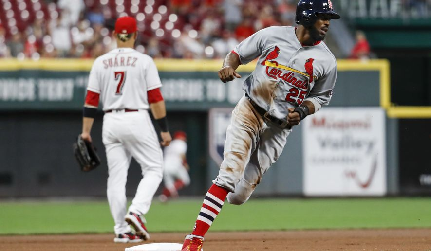 St. Louis Cardinals' Dexter Fowler runs home to score on a double by Yairo Munoz off Cincinnati Reds starting pitcher Homer Bailey during the seventh inning of a baseball game, Tuesday, July 24, 2018, in Cincinnati. (AP Photo/John Minchillo)