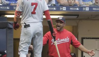 DELETES REFERENCE TO TURNER BEING EJECTED - Washington Nationals manager Dave Martinez yells after Trea Turner was called out on strikes during the second inning of a baseball game against the Milwaukee Brewers on Monday, July 23, 2018, in Milwaukee. (AP Photo/Morry Gash)