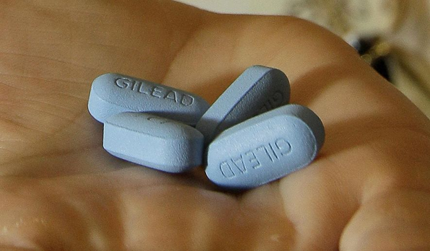 In this May 10, 2012, file photo, a doctor holds Truvada pills at her office in San Francisco. New research shows more promise for using AIDS treatment drugs, such as Truvada, as a prevention tool, to help keep uninfected people from catching HIV during sex with a partner who has the virus. Truvada has been shown to help prevent infection when one partner has the virus and one does not, but the evidence so far has been strongest for male-female couples. (AP Photo/Jeff Chiu, File)