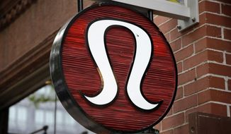 FILE - This Monday, June 5, 2017 file photo, shows a Lululemon Athletica logo outside a store on Newbury Street in Boston. Lululemon on Tuesday, July 24, 2018 named Calvin McDonald as its new CEO, replacing Laurent Potdevin who resigned earlier this year after the yoga gear maker said he fell short of its standards of conduct. (AP Photo/Steven Senne, File)
