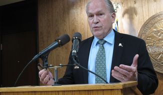 FILE--In this May 13, 2018, file photo, Alaska Gov. Bill Walker speaks with reporters after the Alaska Legislature finished its work and ended the extended legislative session in Juneau, Alaska. Walker leads rivals Mead Treadwell, Mark Begich and Mike Dunleavy in available cash as the campaign season heats up. (AP Photo/Becky Bohrer, file)