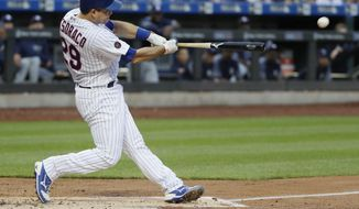 New York Mets' Devin Mesoraco hits a three-run double during the first inning of against the San Diego Padres in a baseball game Tuesday, July 24, 2018, in New York. (AP Photo/Frank Franklin II)