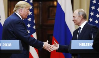 In this file photo taken on Monday, July 16, 2018, U.S. President Donald Trump shakes hand with Russian President Vladimir Putin at the end of the press conference after their meeting at the Presidential Palace in Helsinki, Finland. (AP Photo/Alexander Zemlianichenko, File)