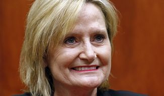 FILE - In this May 1, 2018 file photo, Mississippi Republican Sen. Cindy Hyde-Smith is photographed in a media sit-down in Ridgeland, Miss. Hyde-Smith, the appointed U.S. senator in Mississippi, is raising more money so far than her challengers in a special election. Campaign finance reports show the Republican Sen. Hyde-Smith collected nearly $1.6 million through the end of June. That compares to $308,236 raised by Democrat Mike Espy and $272,263 raised by Republican Chris McDaniel. (AP Photo/Rogelio V. Solis, File)