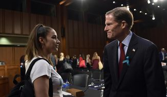 "Olympic gold medalist Aly Raisman, left, talks with Sen. Richard Blumenthal, D-Conn., right, following a Senate Commerce subcommittee hearing on ""Strengthening and Empowering U.S. Amateur Athletes,"" on Capitol Hill in Washington, Tuesday, July 24, 2018. (AP Photo/Susan Walsh)"