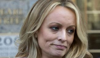 Adult film actress Stormy Daniels speaks outside federal court, in New York, in this April 16, 2018, file photo.  Glendon Crain, the husband of porn film performer Stormy Daniels, filed for divorce in Texas, on July 18, 2018. Daniels, whose real name is Stephanie Clifford, claims to have had sex with Donald Trump before he became president, something Trump has denied. Crain alleged adultery as grounds for the divorce. (AP Photo/Mary Altaffer) ** FILE **
