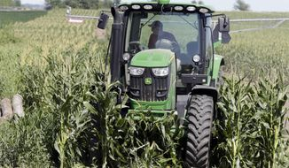 The Agriculture Department predicts a 10 percent uptick from last year in farm profit to $69.4 billion, according to the agency's first forecast for 2019. (Associated Press/File)