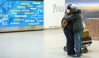 """A recent friendly arrival at John F. Kennedy International Airport in New York. A major Gallup poll is now gauging """"migrant acceptance"""" in 140 nations, including the U.S. Iceland tops the list at the most accepting. (Associated Press)"""
