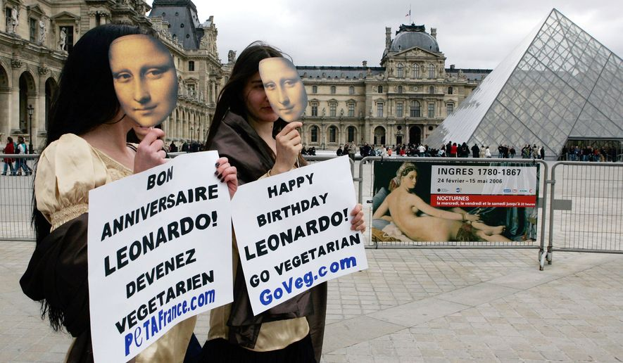 Members from the People for Ethical Treatment of Animals (PETA) dressed as Mona Lisa, demonstrate in front of the Louvre Museum, in Paris, Thursday April 13, 2006 to promote vegetarianism. PETA share the belief that Leonardo Da Vinci was a vegetarian. (AP Photo/Francois Mori)