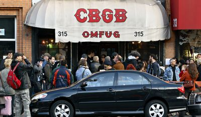 CBGB fans gather outside of the iconic New York club to attend its final concert on Sunday, Oct. 15, 2006, in New York. A homeless advocacy group, which owns the property, is not renewing CBGB's lease. It expired in August 2005. The grungy club, which has been a fixture in downtown New York, will close October 31st. (AP Photo/Adam Rountree)