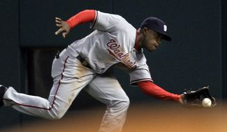 Washington Nationals right fielder Willie Harris just misses a double by St. Louis Cardinals' Ryan Ludwick during the second inning of a baseball game Monday, May 17, 2010, in St. Louis. (AP Photo/Jeff Roberson) **FILE**