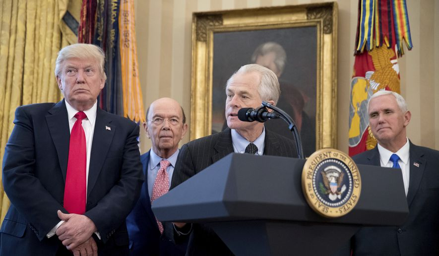 National Trade Council adviser Peter Navarro, second from right, accompanied by from left, President Donald Trump, Secretary of Commerce Wilbur Ross, and Vice President Mike Pence, speaks during a signing ceremony for executive orders regarding trade in the Oval Office at the White House, Friday, March 31, 2017, in Washington. Trump spoke to the media but left before signing the orders. (AP Photo/Andrew Harnik) **FILE**