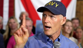 Florida Gov. Rick Scott announces his bid to run for the U.S. Senate at a news conference Monday, April 9, 2018, in Orlando, Fla. (AP Photo/John Raoux)