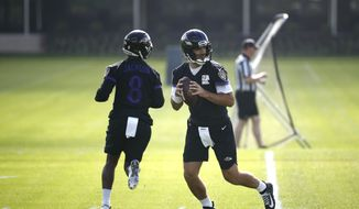 Baltimore Ravens quarterback Joe Flacco, right, runs a drill past quarterback Lamar Jackson during an NFL football practice at the team's headquarters in Owings Mills, Md., Tuesday, June 12, 2018. (AP Photo/Patrick Semansky) **FILE**