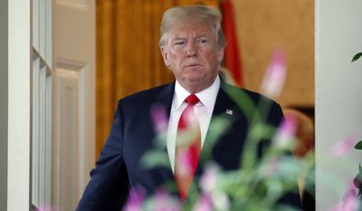 President Donald Trump steps out of the Oval Office followed by European Commission president Jean-Claude Juncker as they walk to speak in the Rose Garden of the White House, Wednesday, July 25, 2018, in Washington.(AP Photo/Alex Brandon)