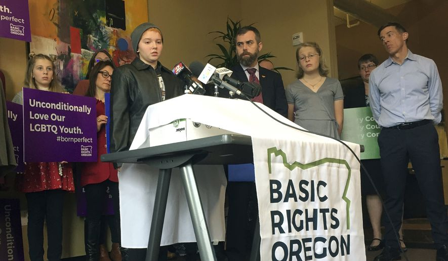 Elliot Yoder, 16, a transgender student at Dallas High School in Dallas, Ore., speaks at a news conference held by ACLU Oregon and Basic Rights in Portland, Ore., to protest a federal lawsuit filed against the Dallas School District over its policy on the treatment of transgender students, in this Nov. 16, 2017, photo. (AP Photo/Gillian Flaccus) ** FILE **