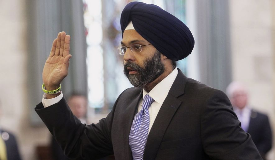 "In this Jan. 16, 2018, file photo, Gurbir Grewal is sworn in before testifying in front of the senate judiciary committee in Trenton, N.J. WKXW-FM radio hosts Dennis Malloy and Judi Franco are receiving heavy criticism for repeatedly referring to Grewal, the state's attorney general, as ""turban man"" on air, Wednesday, July 25, The Record reports. (Chris Pedota/The Record via AP, File)"