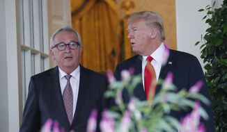 President Donald Trump, right, and European Commission president Jean-Claude Juncker arrive to speak in the Rose Garden of the White House, Wednesday, July 25, 2018, in Washington.(AP Photo/Alex Brandon)