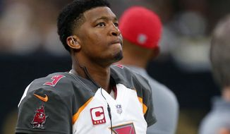 FILE - In this Nov. 5, 2017, file photo, Tampa Bay Buccaneers quarterback Jameis Winston (3) watches from the sideline during the second half of an NFL football game against the New Orleans Saints in New Orleans. Winston's three-game suspension for violating the NFL's personal conduct policy predictably was a hot topic of discussion when the Tampa Bay Buccaneers reported for training camp. That is, except for the quarterback himself. The fourth-year pro, who'll miss the start to a season in which the Bucs are hoping to end a decade-long playoff drought, was not among three players the team made available for interviews Wednesday at One Buccaneer Place. (AP Photo/Butch Dill, File)