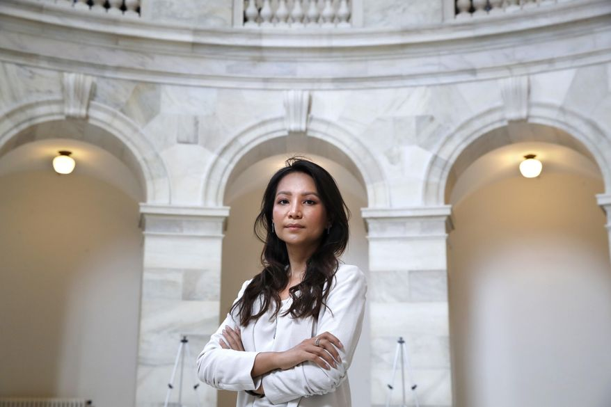 In this July 17, 2018, photo, Kem Monovithya, a Cambodian political activist and daughter of Kem Sokha, the jailed leader of Cambodia's main opposition party, poses for a portrait on Capitol Hill in Washington. Kem said she can't go home because she fears she, too, will be arrested as part of a government crackdown that has banned the political party her father led, shut down news outlets and scattered hundreds of Cambodian politicians, human rights activists and journalists into exile in the U.S., Australia, Thailand and other countries. (AP Photo/Jacquelyn Martin)