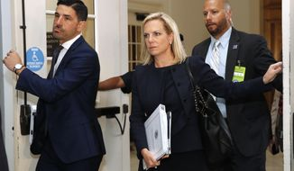 Homeland Security Secretary Kirstjen Nielsen, center, arrives for a closed doors meeting with the Congressional Hispanic Caucus, Wednesday, July 25, 2018, on Capitol Hill in Washington. (AP Photo/Jacquelyn Martin)