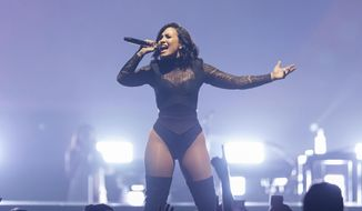 Demi Lovato performs during The Future Now Tour in New York, July 8, 2016. Photo by Michael Zorn/Invision/AP) ** FILE **