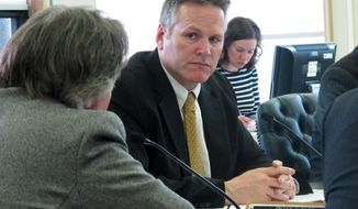 FILE - In this, May 17, 2016, file photo, Alaska state Sen. Mike Dunleavy listens during a Senate Finance Committee meeting in Juneau, Alaska. A brother of Republican gubernatorial candidate Dunleavy and a prominent sport fishing activist have put hundreds of thousands of dollars into a third-party group supporting Dunleavy's candidacy, a sign of Alaska's new political reality. (AP Photo/Becky Bohrer, File)