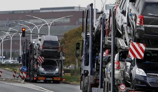 This file photo dated Thursday, Sept. 10, 2009, shows car transporters in Ruesselsheim, central Germany. (AP Photo/Michael Probst, File)