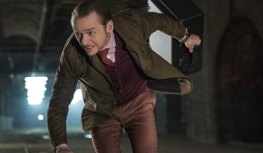 """Actors Simon Pegg runs in a scene from """"Mission: Impossible - Fallout."""" (Chiabella James/Paramount Pictures and Skydance via AP)  ** FILE **"""