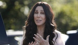 In this Aug. 21, 2016, file photo, singer and actress Cher stops to talk to media as she leaves a fundraiser for Hillary Clinton at the Pilgrim Monument and Provincetown Museum in Provincetown, Mass. (AP Photo/Carolyn Kaster, File)