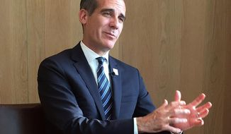 Eric Garcetti, mayor of Los Angeles and host city of the 2028 Olympic and Paralympic Games speaks during an interview at a hotel in Tokyo Wednesday, July 25, 2018. In an era when many cities are hesitant to bid for the Olympics, Garcetti is convinced his city has a winning formula to make the games a success. (AP Photo/Alessandro Libri)