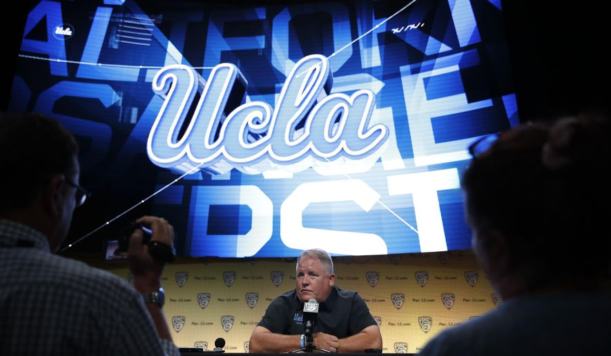 UCLA  coach Chip Kelly talks to reporters at the Pac-12 Conference NCAA college football media day in Los Angeles, Wednesday, July 25, 2018. (AP Photo/Jae C. Hong)