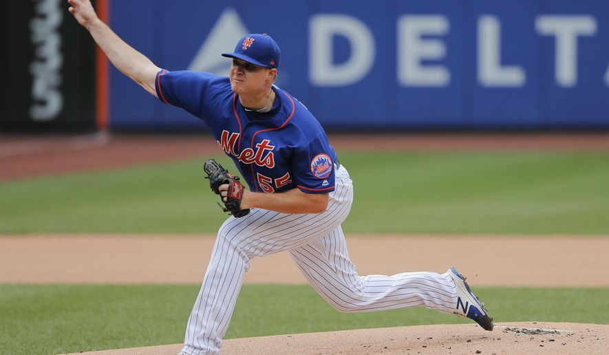 New York Mets pitcher Corey Oswalt (55) delivers against the San Diego Padres during the first inning of a baseball game, Wednesday, July 25, 2018, in New York. (AP Photo/Julie Jacobson)