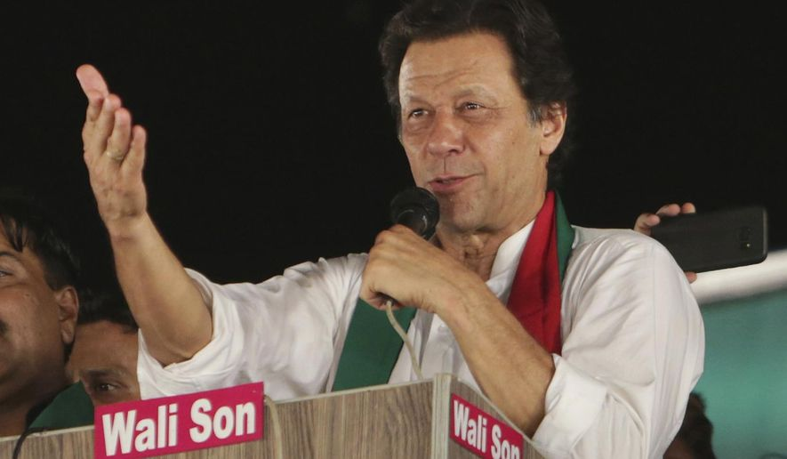 FILE - In this July 18, 2018, file photo, Pakistani politician Imran Khan, chief of Pakistan Tehreek-e-Insaf party, addresses supporters during an election campaign in Lahore, Pakistan. As Pakistanis prepare to make history on Wednesday by electing a third consecutive civilian government, rights activists, analysts and even some candidates say the campaign has been among the country's dirtiest imperiling the country's democratic future. (AP Photo/K.M. Chaudary, File)