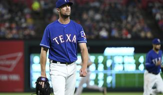 FILE - In this June 7, 2018, file photo, Texas Rangers starting pitcher Cole Hamels walks back to the dugout after the top of the sixth inning of a baseball game against the Houston Astros, in Arlington, Texas. Less than a week before the non-waiver trade deadline, the veteran lefty is in what he calls the worst stretch of his career.  (AP Photo/Jeffrey McWhorter, File)