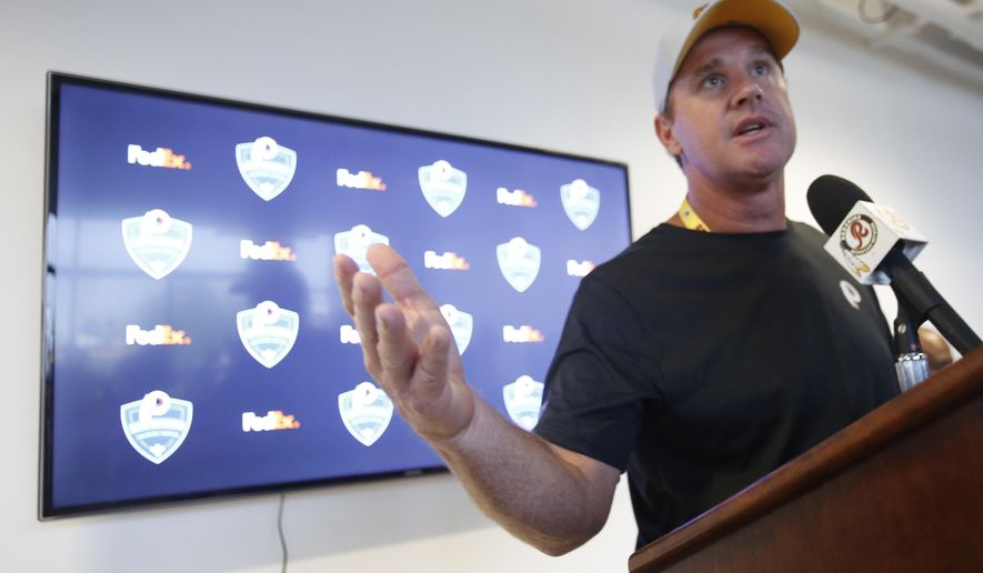 Washington Redskins coach Jay Gruden gestures during an NFL football press conference at the start of training camp in Richmond, Va., Wednesday, July 25, 2018. (AP Photo/Steve Helber)