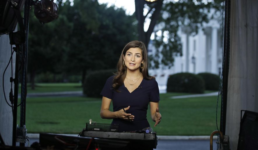 "CNN White House correspondent Kaitlan Collins talks during a live shot in front of the White House, Wednesday, July 25, 2018, in Washington. Collins says the White House denied her access to President Donald Trump's Rose Garden statement with the European Union Commission president because officials found her earlier questions ""inappropriate."" (AP Photo/Alex Brandon) ** FILE **"