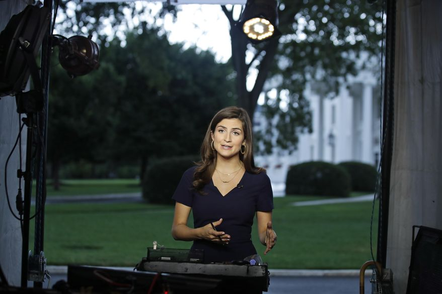 """CNN White House correspondent Kaitlan Collins talks during a live shot in front of the White House, Wednesday, July 25, 2018, in Washington. Collins says the White House denied her access to President Donald Trump's Rose Garden statement with the European Union Commission president because officials found her earlier questions """"inappropriate."""" (AP Photo/Alex Brandon) ** FILE **"""