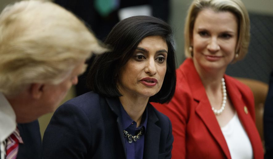 In this March 22, 2017, file photo President Donald Trump , left, and Texas State Sen. Dawn Buckingham, right, listen as Administrator of the Centers for Medicare and Medicaid Services Seema Verma speaks during a meeting on women in healthcare in the Roosevelt Room of the White House in Washington. (AP Photo/Evan Vucci, File) **FILE**