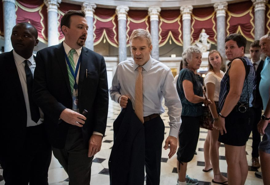 Rep. Jim Jordan, Ohio Republican, (center) has built a reputation as a right-wing brawler, willing to battle Democrats and Republican leaders alike. He is challenging Rep. Kevin McCarthy, of California, to succeed outgoing House Speaker Paul D. Ryan. walks to the House chamber as he prepares to file articles of impeachment against Deputy Attorney General Rod J. Rosenstein, on Capitol Hill in Washington, Thursday, July 26, 2018. (AP Photo/J. Scott Applewhite) (Associated Press photographs)