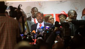 """Nelson Chamisa, center, head of the MDC opposition alliance is seen during a press briefing at the party headquarters in Harare, Wednesday, July, 25, 2018. Chamisa urged supporters to vote """" overwhelmingly for change"""" in upcoming election scheduled for july 30, 2018, the first election since the November resignation of longtime leader Robert Mugabe. (AP Photo/Tsvangirayi Mukwazhi)"""