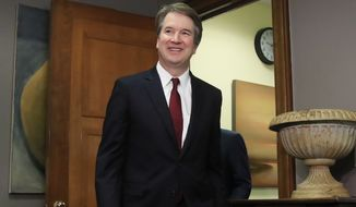 Supreme Court nominee Brett Kavanaugh arrives for a meeting with Sen. Sen. Bob Corker, R-Tenn., on Capitol Hill in Washington, Thursday, July 19, 2018. (AP Photo/Manuel Balce Ceneta)