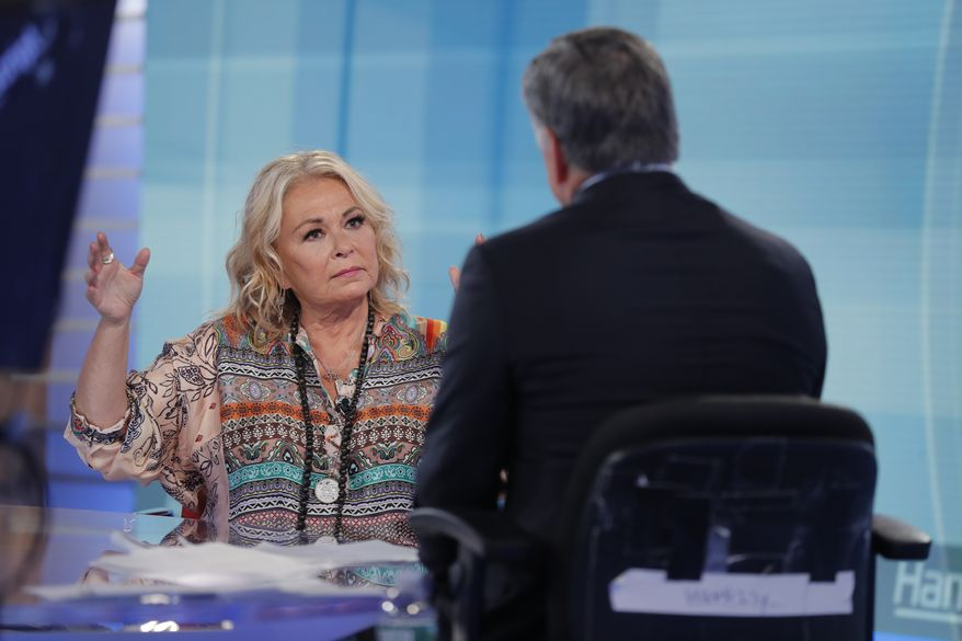 "Roseanne Barr talks with Fox News talk show host Sean Hannity while being interviewed during a taping of his show, Thursday, July 26, 2018, in New York. The comedian and actress appeared on on the Fox News show ""Hannity"" on Thursday at 9 p.m. EDT for the first time since she was fired from ABC which canceled its successful reboot of ""Roseanne"" in May following the star's racist tweet likening former Obama adviser Valerie Jarrett to a cross between the Muslim Brotherhood and a ""Planet of the Apes"" actor. (AP Photo/Julie Jacobson)"