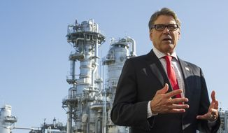 Secretary of Energy Rick Perry, with the main cyrogenic heating exchange behind him, speaks with reporters at Dominion Energy's Cove Point LNG liquefaction Project facility in Lusby, Md., Thursday, July 26, 2018. The completion of the facilities export expansion project makes it just the second LNG export facility in the U.S. (AP Photo/Cliff Owen)